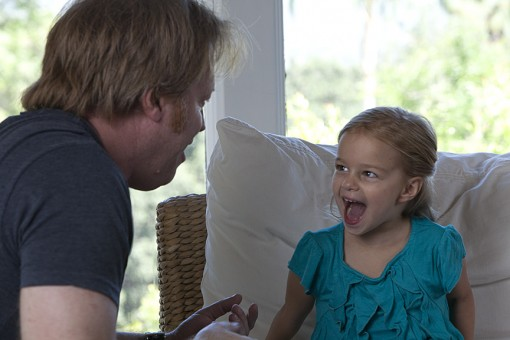 director Greg McDonald working with child actor in a behind the scenes shot