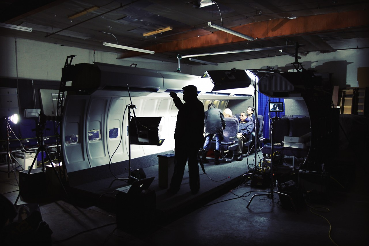 behind the scenes on an airplane set for a travel product