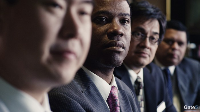 a row of business men in a corporate video production in Los Angeles