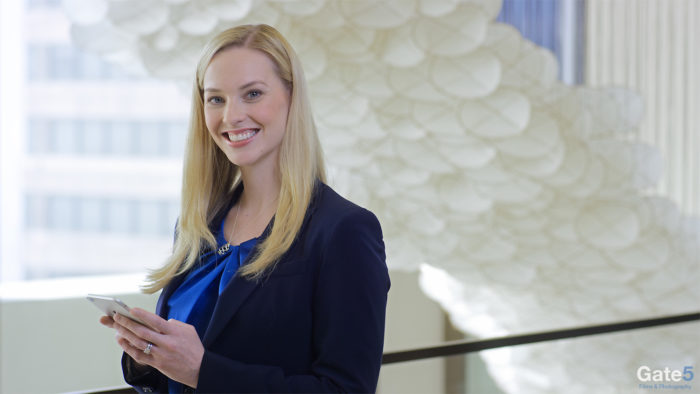 smiling woman in who we are profile employee recruitment video