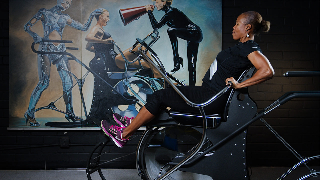 woman trains with high intensity rom machine