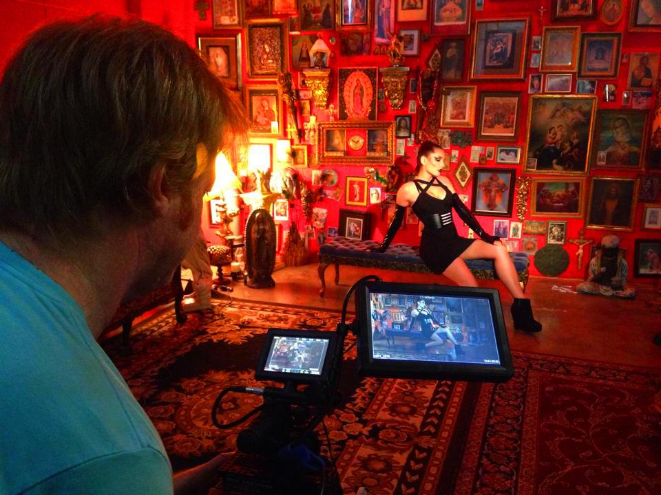 director greg mcdonald checks frame behind the scenes
