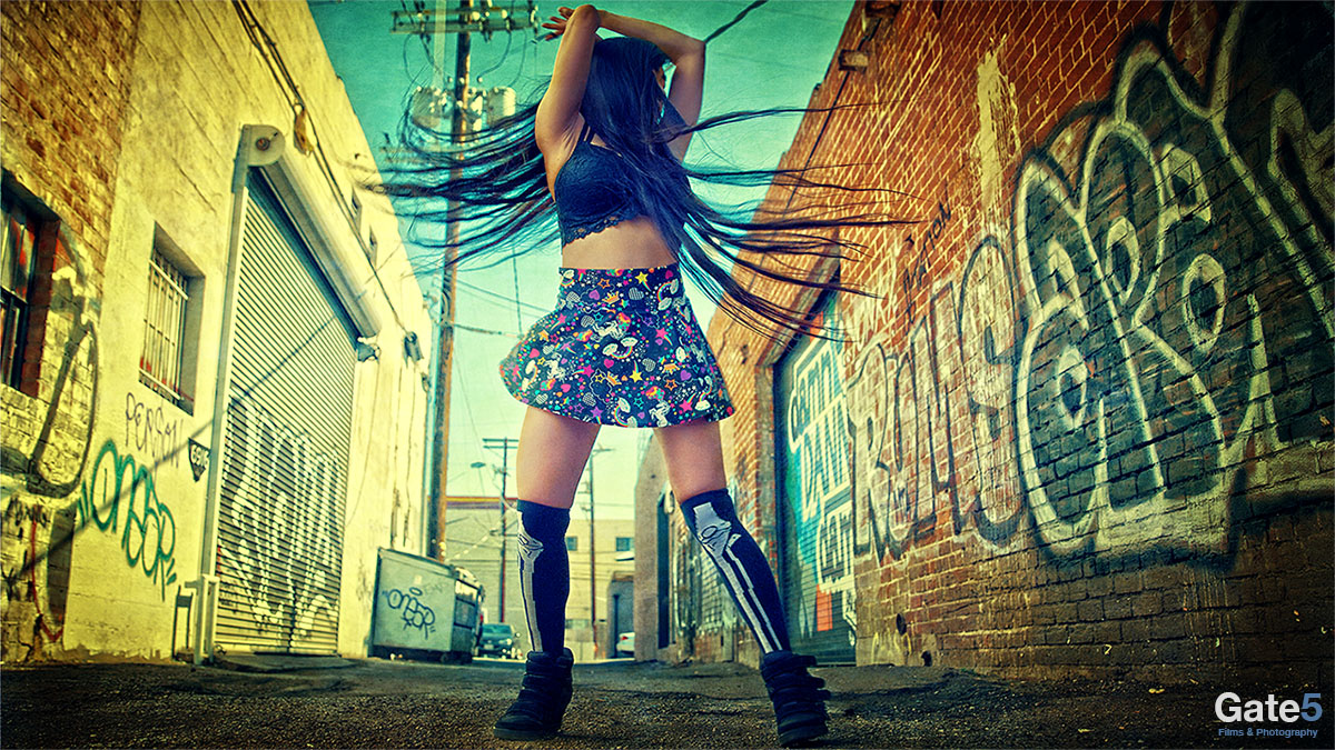 colorful photo fashion model in alley with graffiti hollywood