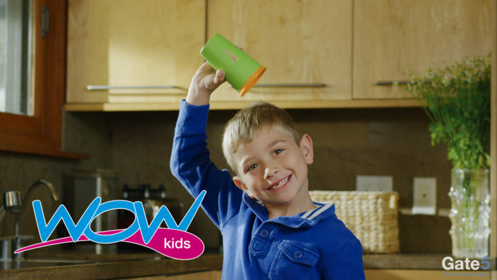 a kid holds a spill free sippy cup over his head in a video ad