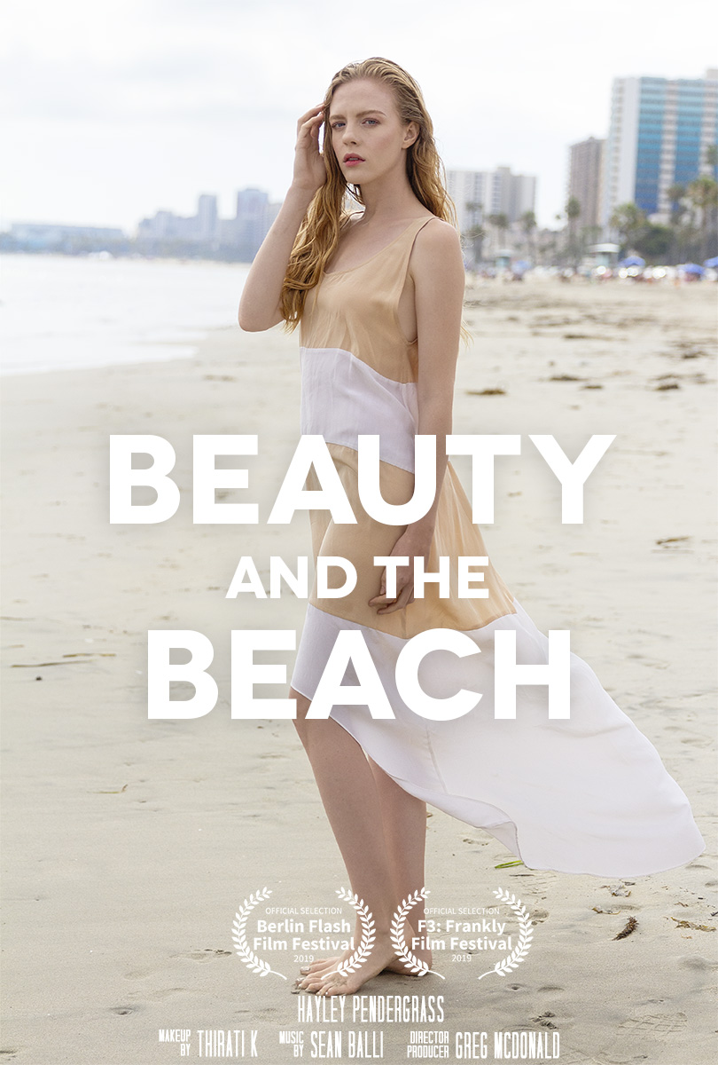 a woman on the beach in a dress in the eco fashion film directed by Greg McDonald