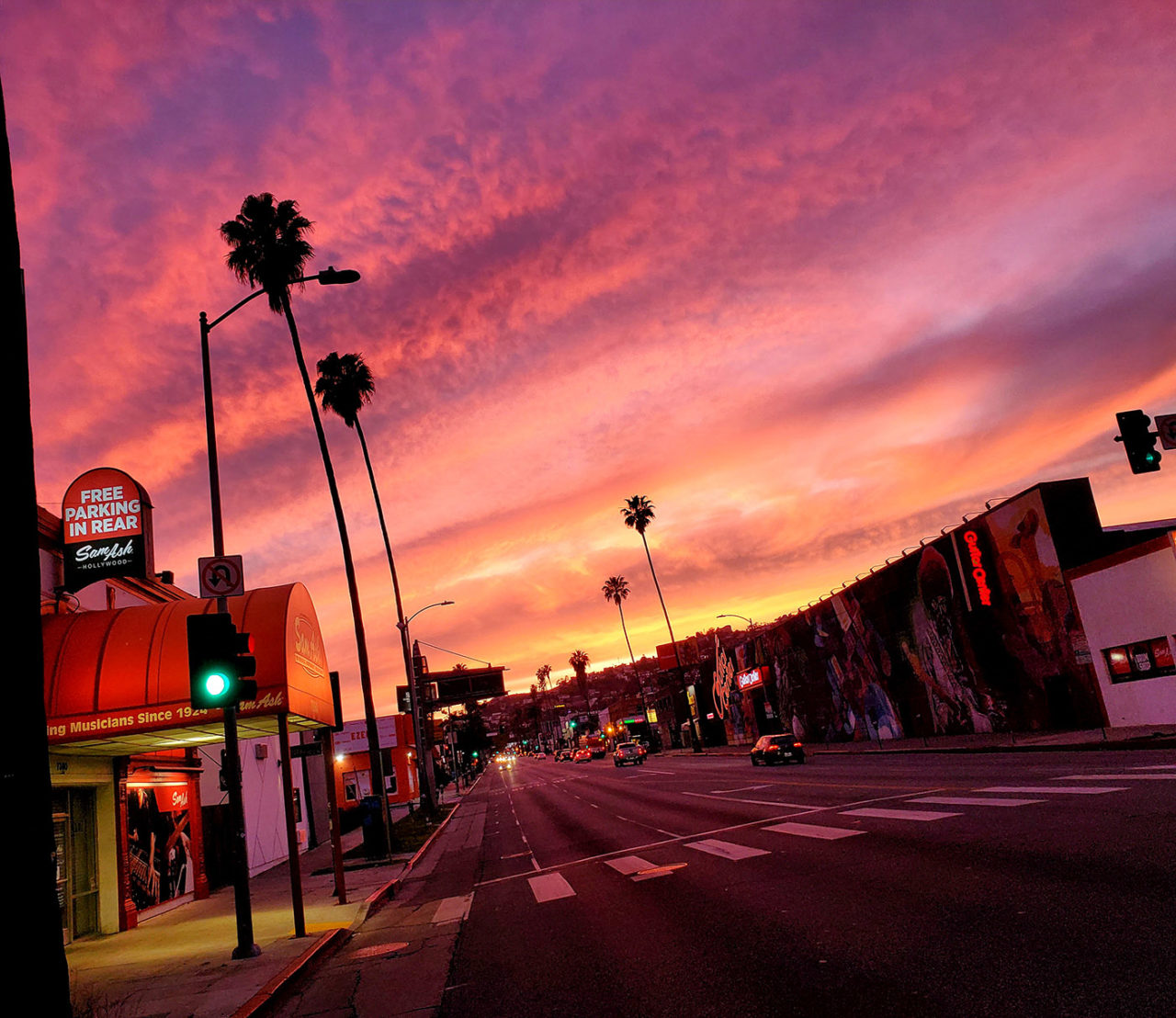 Colorful sunset of a nearly empty Sunset Blvd in Hollywood during Coronavirus stay at home order