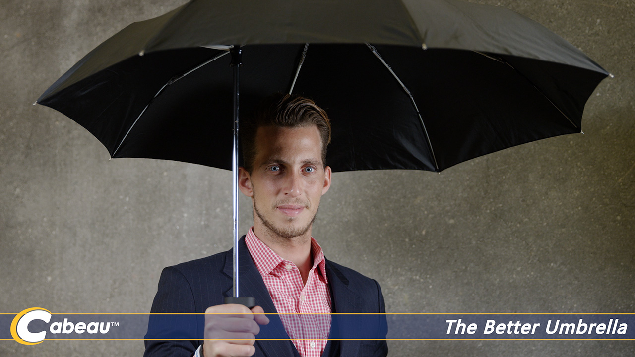 man with a travel umbrella for video marketing production