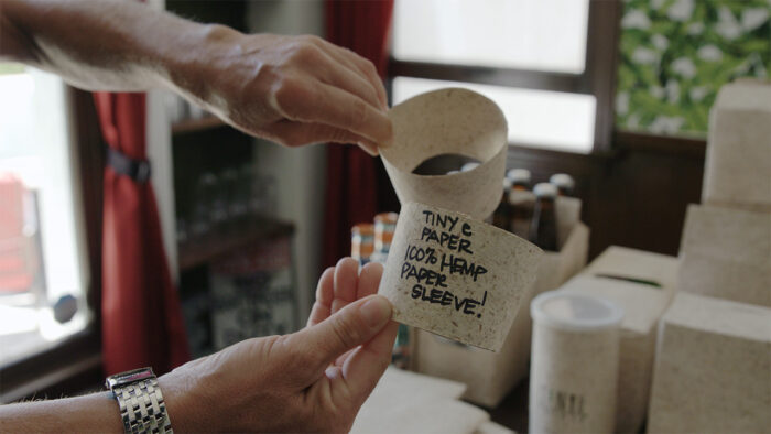 close up of a coffee sleeve made from hemp paper in an episode of a video series on hemp