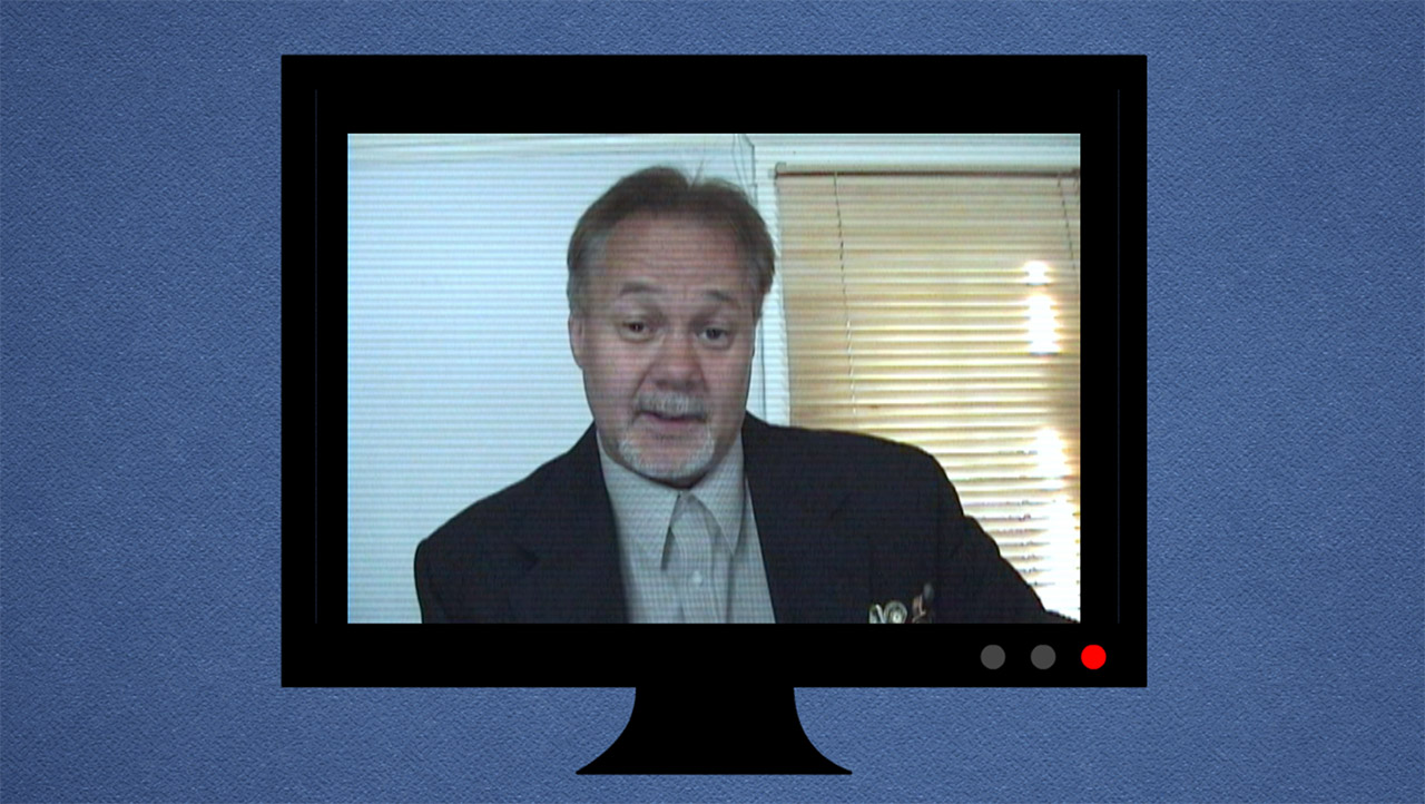 a business man on a screen in a video conference call
